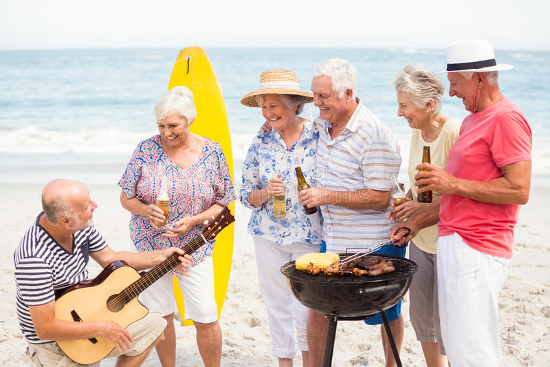Seniors having barbecue royalty free stock images