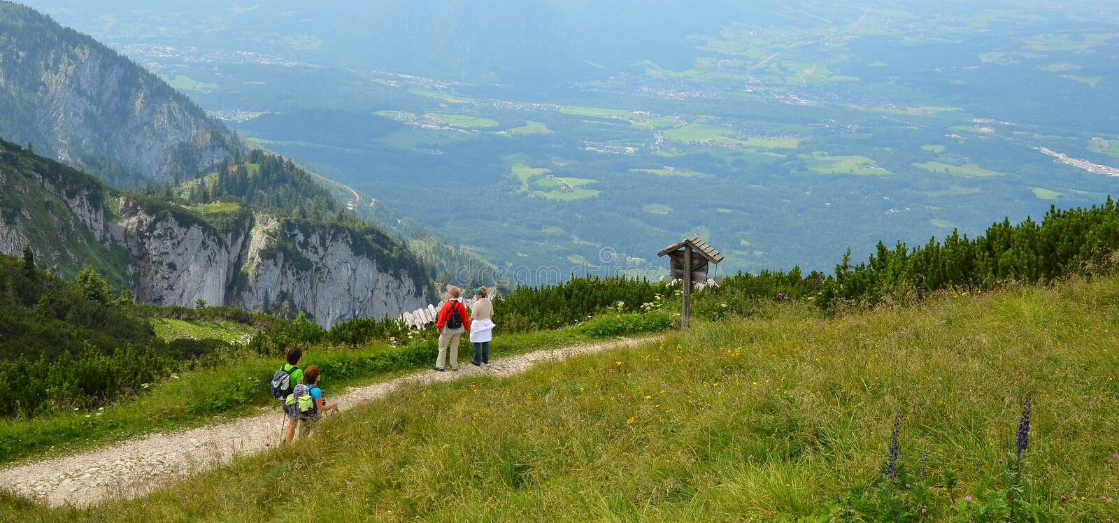 seniors hiking in mountain on summer day stock image