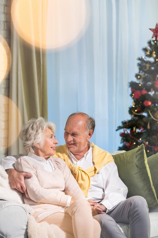 Seniors hugging each other stock images