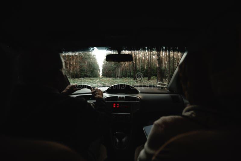 Seniors inside the car. Elderly loving couple in car stock photography