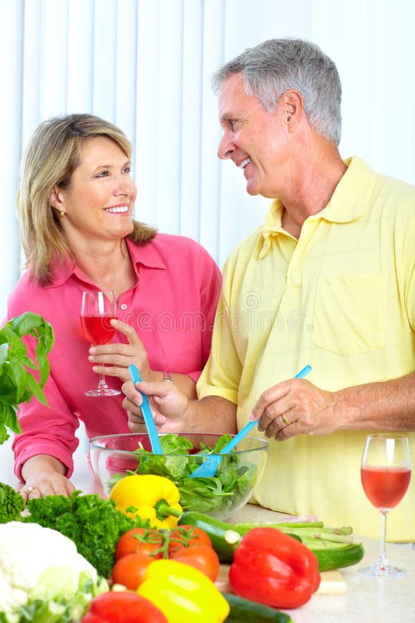 Seniors at kitchen stock image