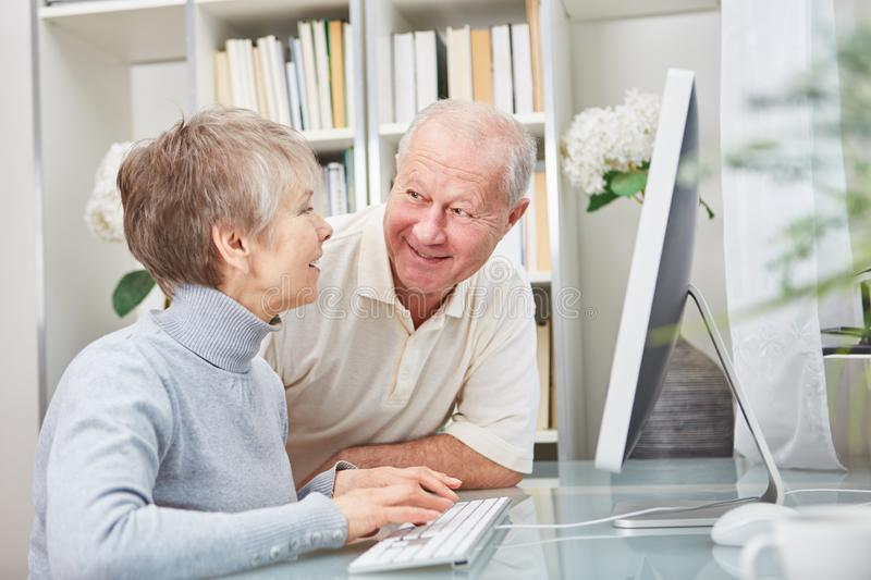Seniors learn how to use computer stock images