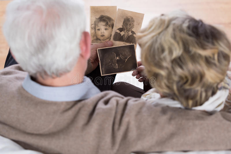 Seniors looking at old pictures stock images