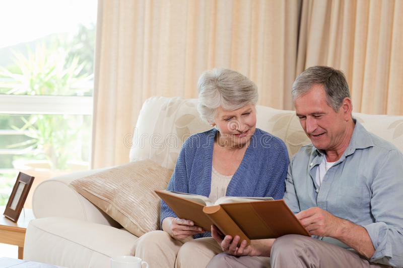 Seniors looking at their photo album royalty free stock photography