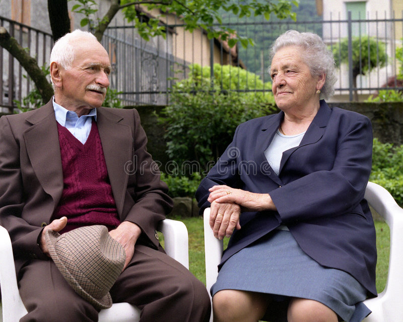 Seniors in love. Elderly retired couple expressing their love for each other stock image
