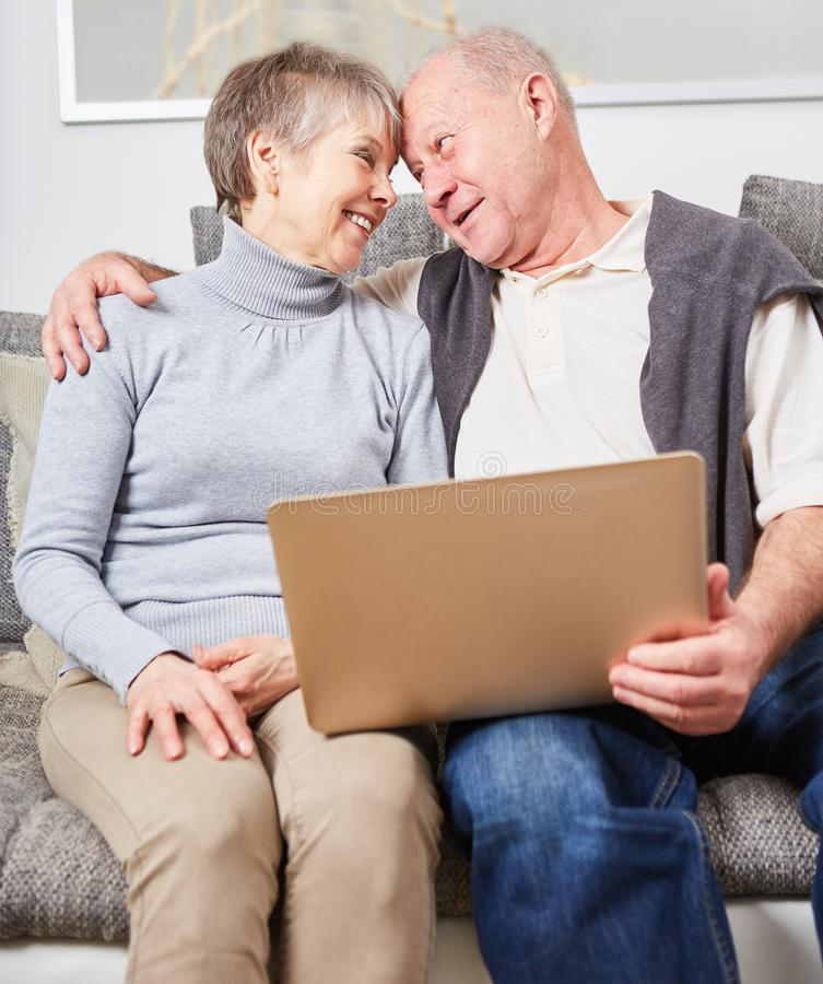 Seniors in love as a couple. Holding a laptop stock images