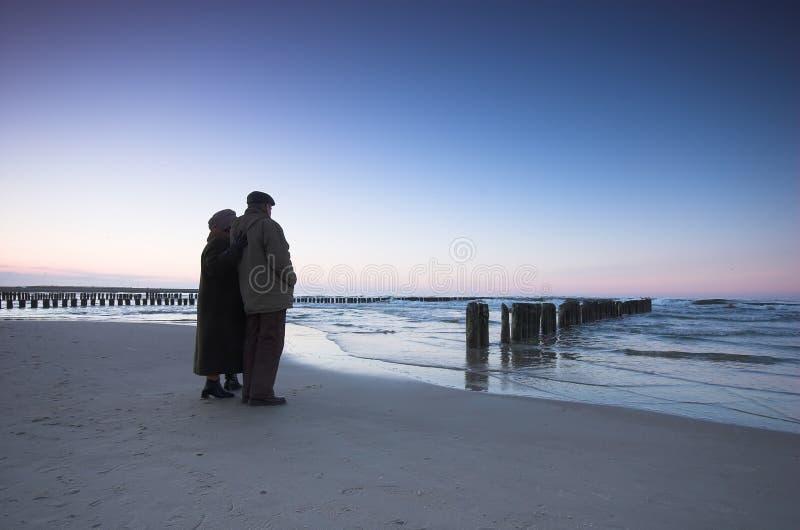 Seniors' love and ocean stock images