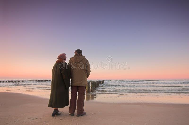 Seniors' love and ocean stock image