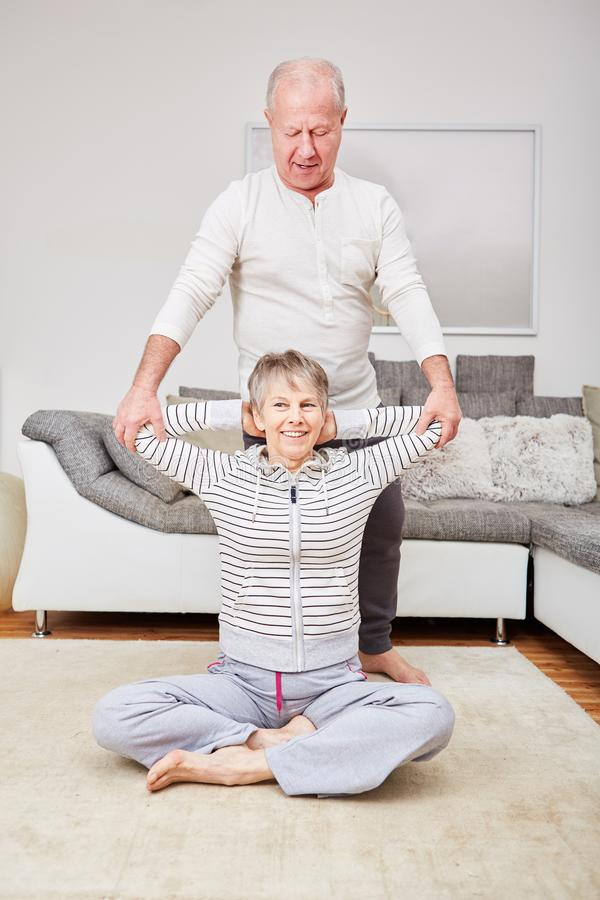 Seniors make fitness exercise. And help each other stretching royalty free stock photo