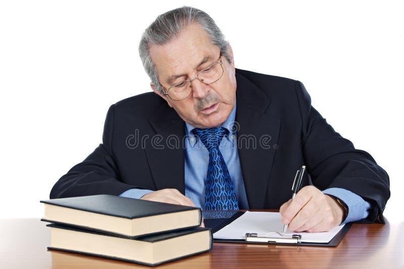 Seniors man writing stock photos