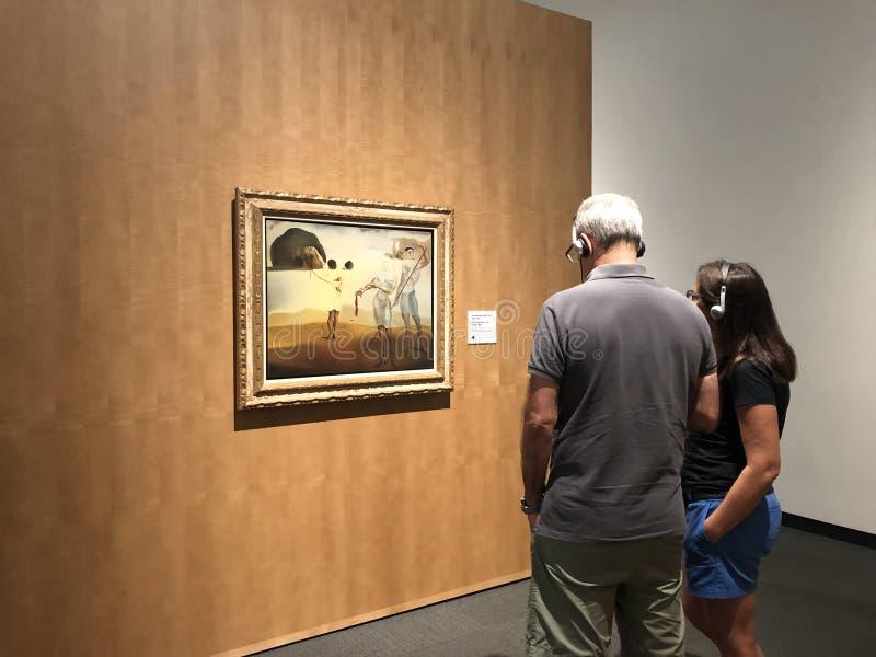 Seniors at museum watching famous art stock photos