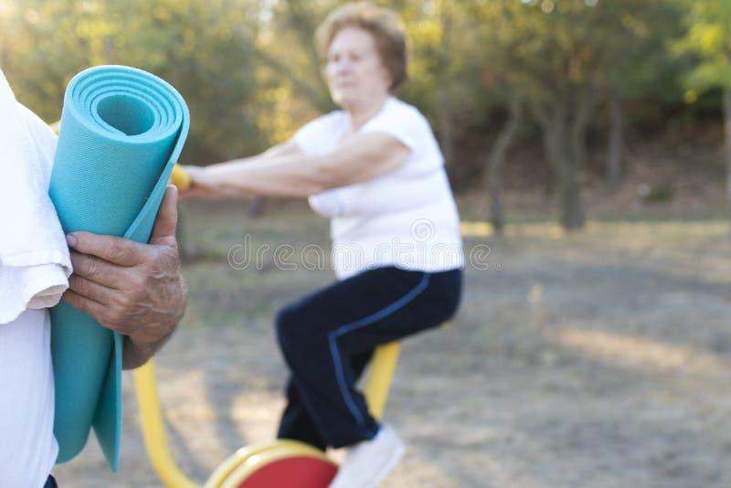 Seniors doing outdoor sports. Seniors people doing outdoor sports stock images