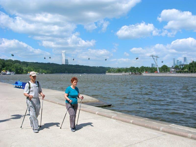 Seniors people, healthy lifestyle, activity, scandinavian walking. Moscow, Russia. Scandinavian walking as healthy lifestyle for seniors people. Man and woman royalty free stock photo