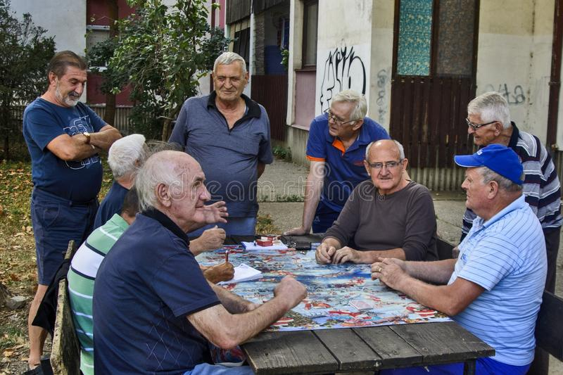 Seniors play cards royalty free stock photography