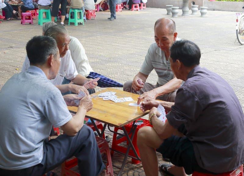 Seniors playing cards royalty free stock image