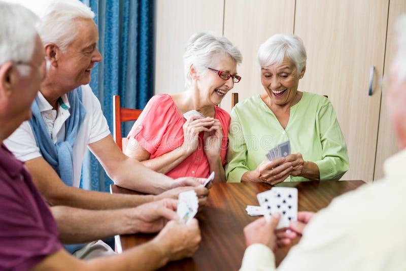 Seniors playing cards stock image