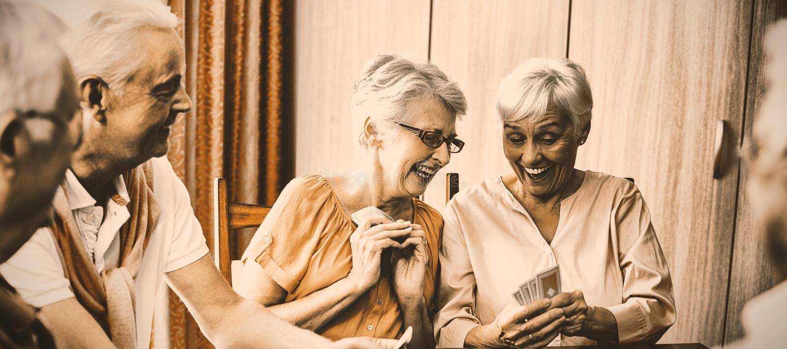 Seniors playing cards royalty free stock photography