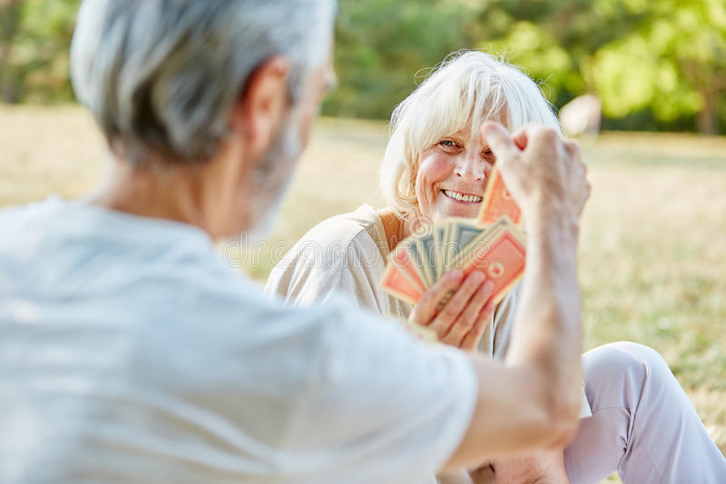 Seniors playing cards together royalty free stock photos