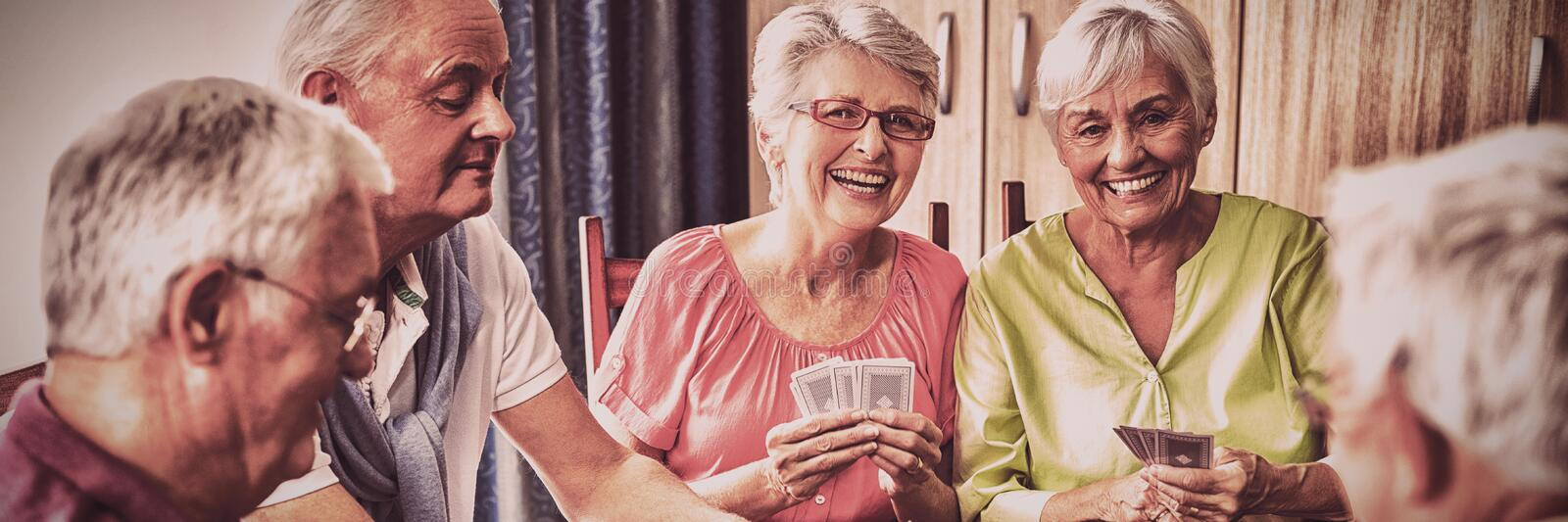 Seniors playing cards together stock image