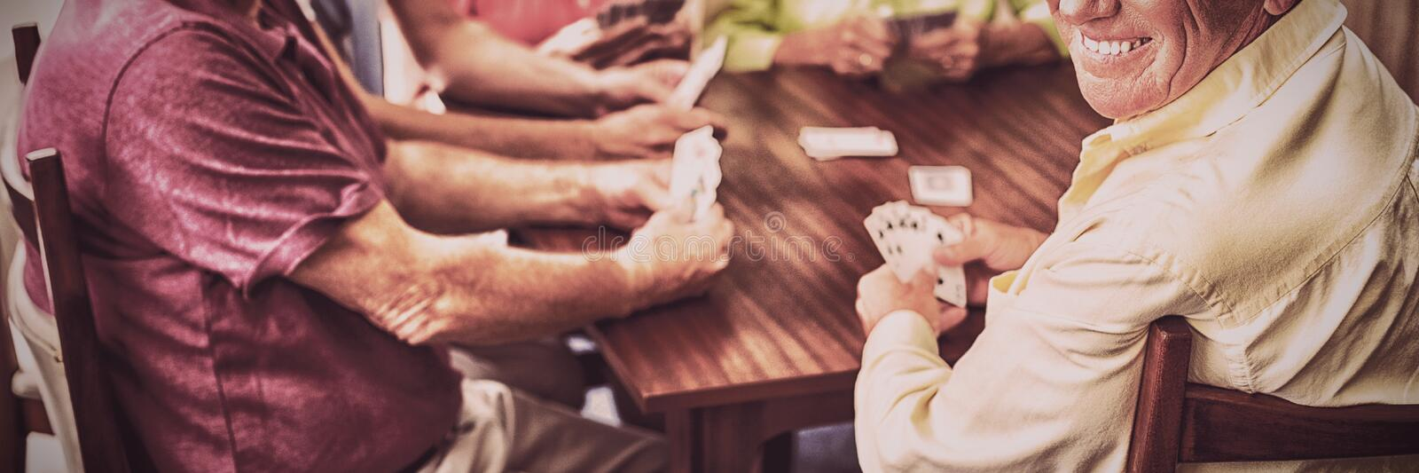 Seniors playing cards together royalty free stock photography