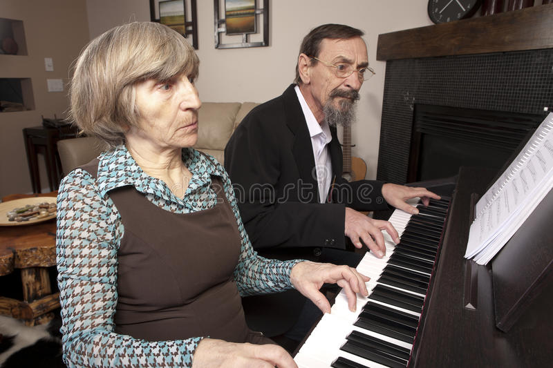Download Seniors playing piano duet stock photo. Image of lifestyle - 23544974