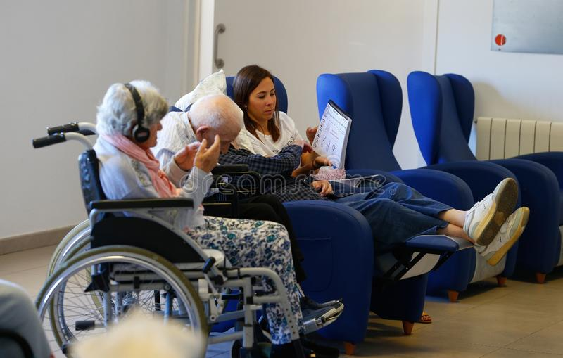 Seniors and nurse during therapeutical mind activities on a nursing home in Mallorca wide. Seniors practice with the help of a nurse some mind activities and stock images