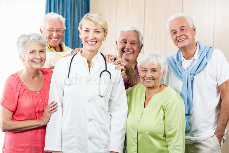 Seniors putting their hands on nurse stock images