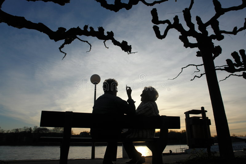 Seniors relaxing silhouette royalty free stock photography