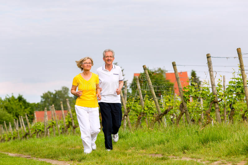 Download Seniors Running In The Nature Doing Sport Stock Photo - Image: 33976082