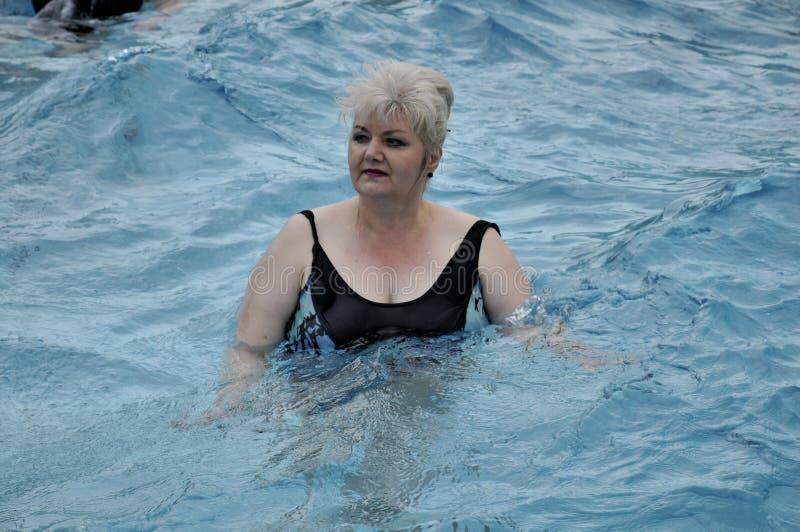 Seniors in simming pool royalty free stock image
