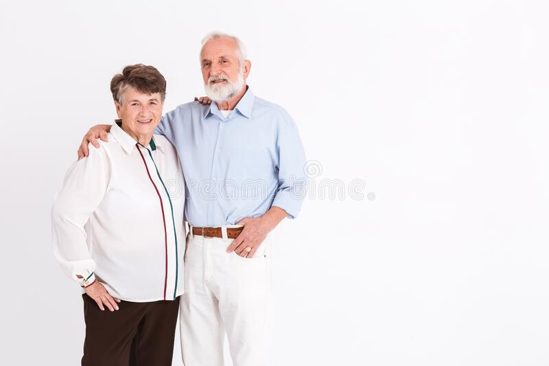 Seniors standing in room royalty free stock photos