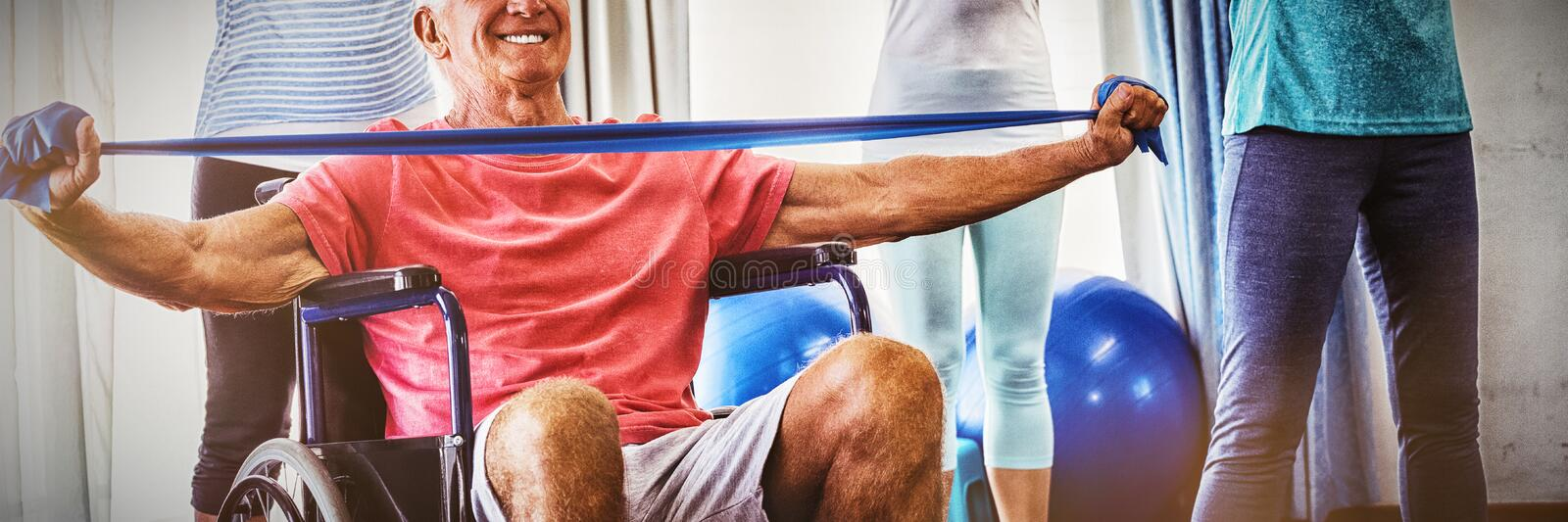 Seniors stretching during fitness class. In retirement house royalty free stock photo