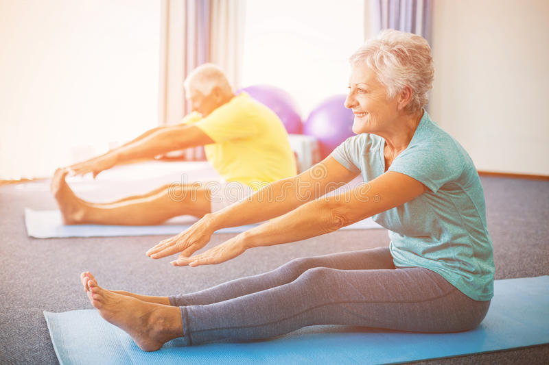 Seniors stretching legs. In studio royalty free stock photo
