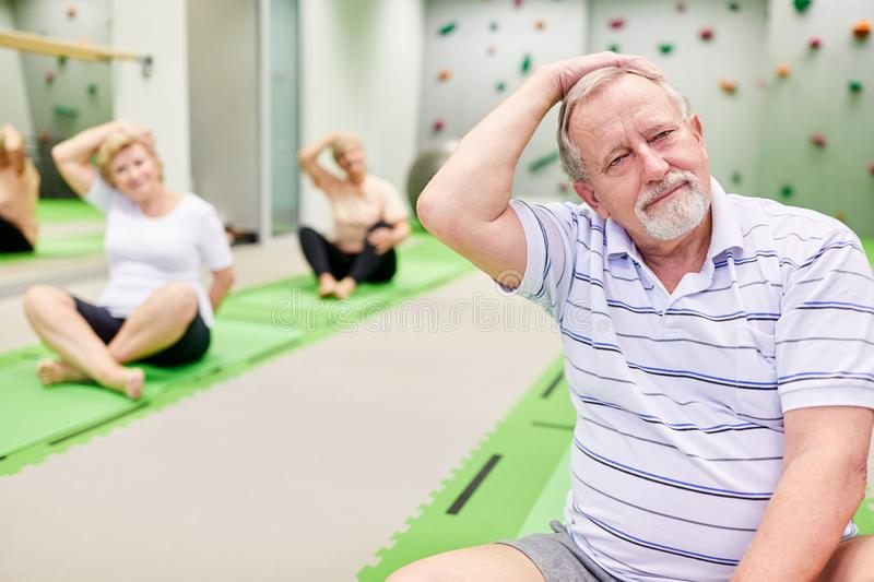 Seniors while stretching in the physiotherapy. Seniors stretching in rehab. Physiotherapy for health and relaxation stock photo