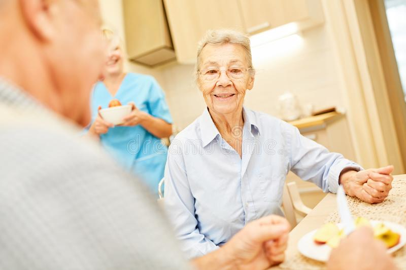 Seniors at the table in assisted living royalty free stock photography