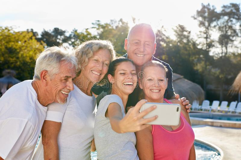 Seniors take a selfie with their smartphone royalty free stock photos