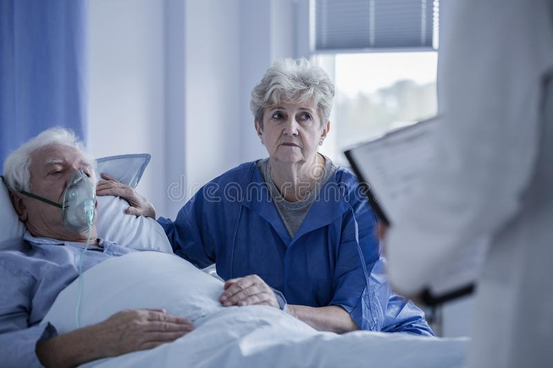 Seniors talking to doctor stock image