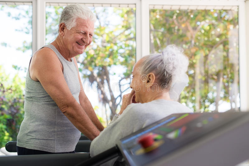 Download Seniors Talking And Working Out In Fitness Club Stock Photo - Image: 25606480