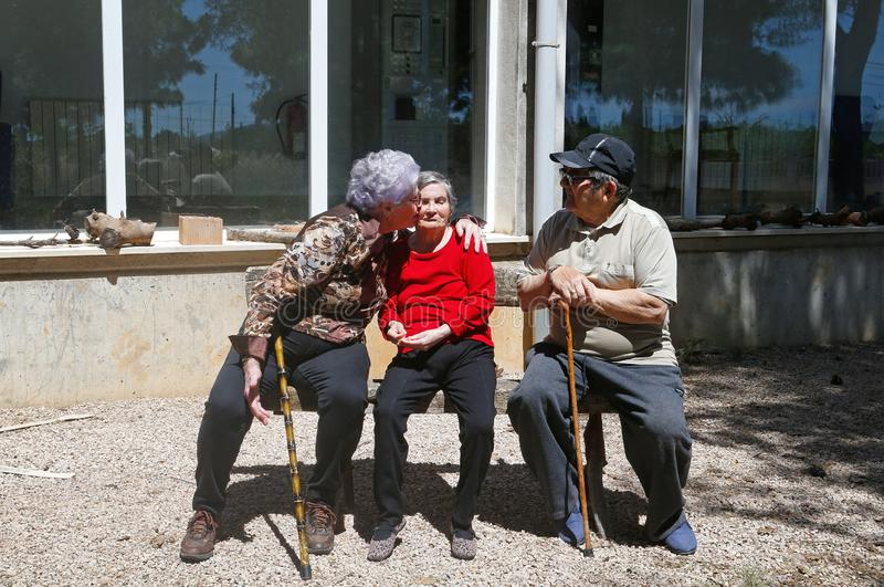 Seniors during their daylife on a nursing home in Mallorca. Seniors pose in the garden of their nursing home in the Spanish island of Mallorca during an open stock photo