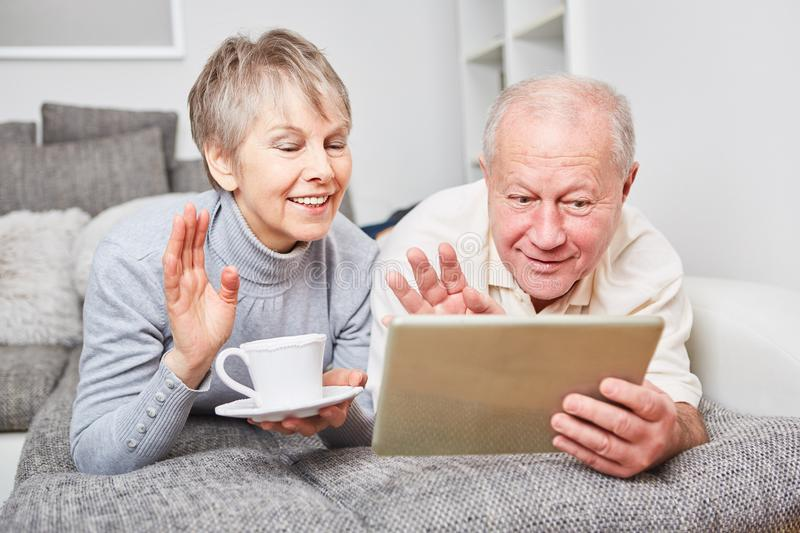 Seniors video chatting with tablet royalty free stock photos