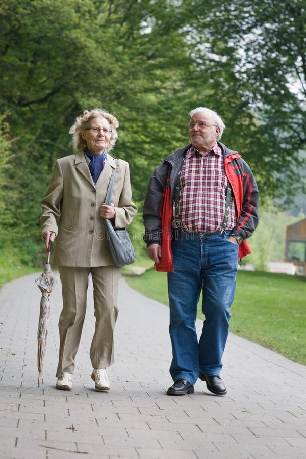 Seniors Walking. Senior Couple walking in Park stock photos