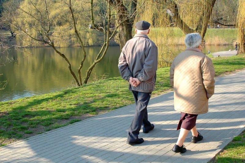 Seniors walking stock photography