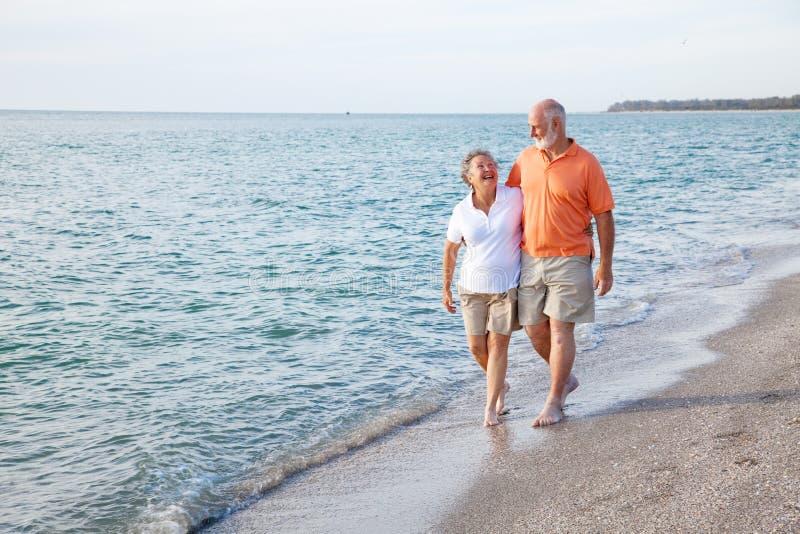Seniors Walking on the Beach. Beautiful senior couple takes a romantic stroll on a tropical beach