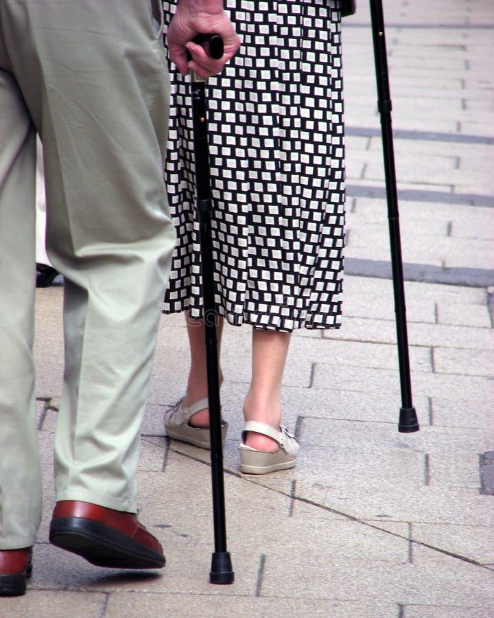 Seniors with walking sticks stock photography