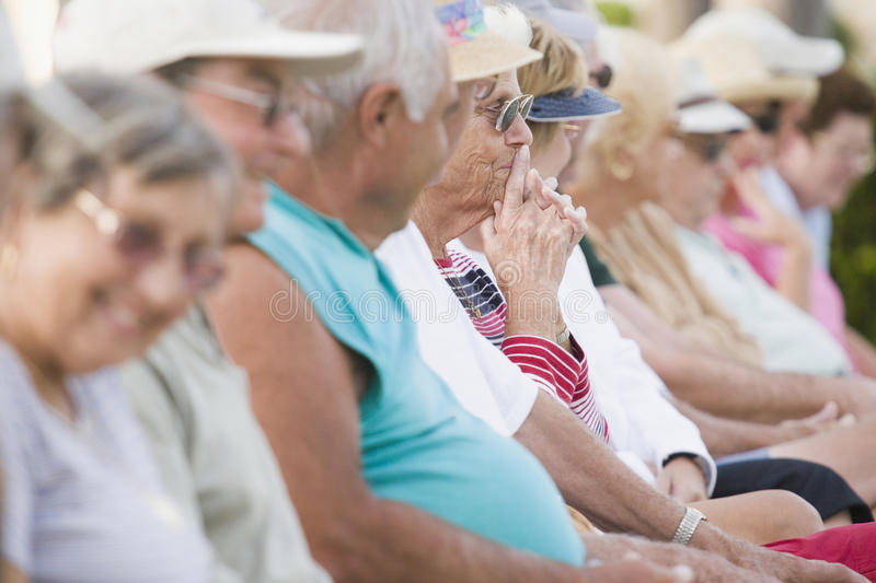 Seniors watching a game stock photography
