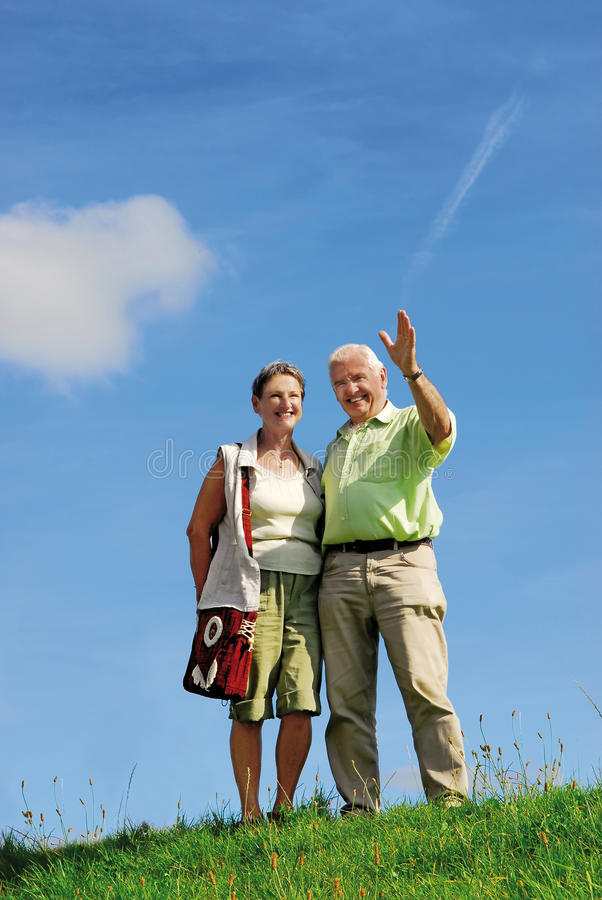 Seniors waving royalty free stock photo