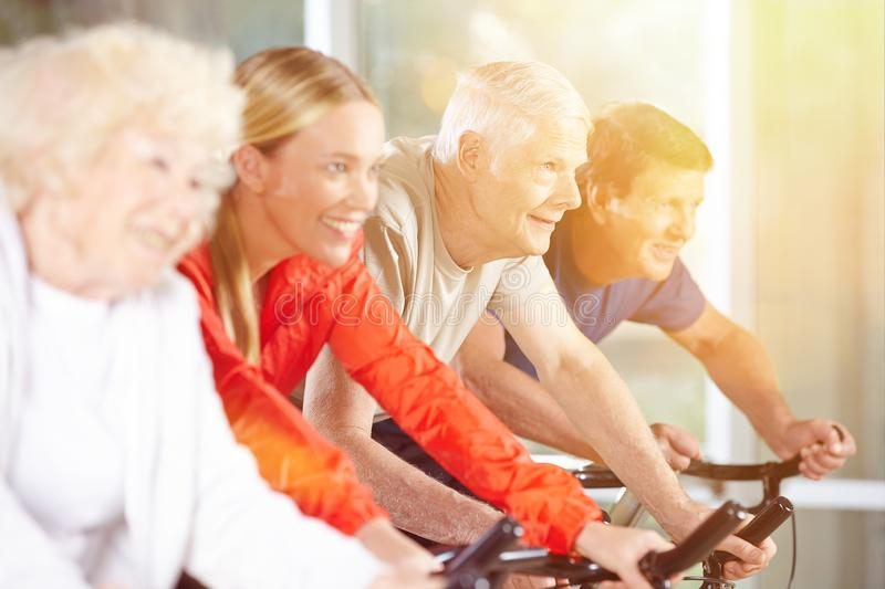 Seniors work out in the fitness center royalty free stock photography