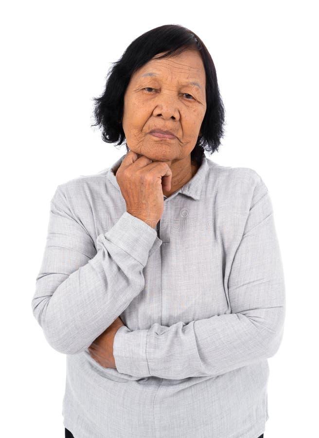 Seniro-Frau sorgte sich und das Denken lokalisiert auf weißem Hintergrund stockfoto