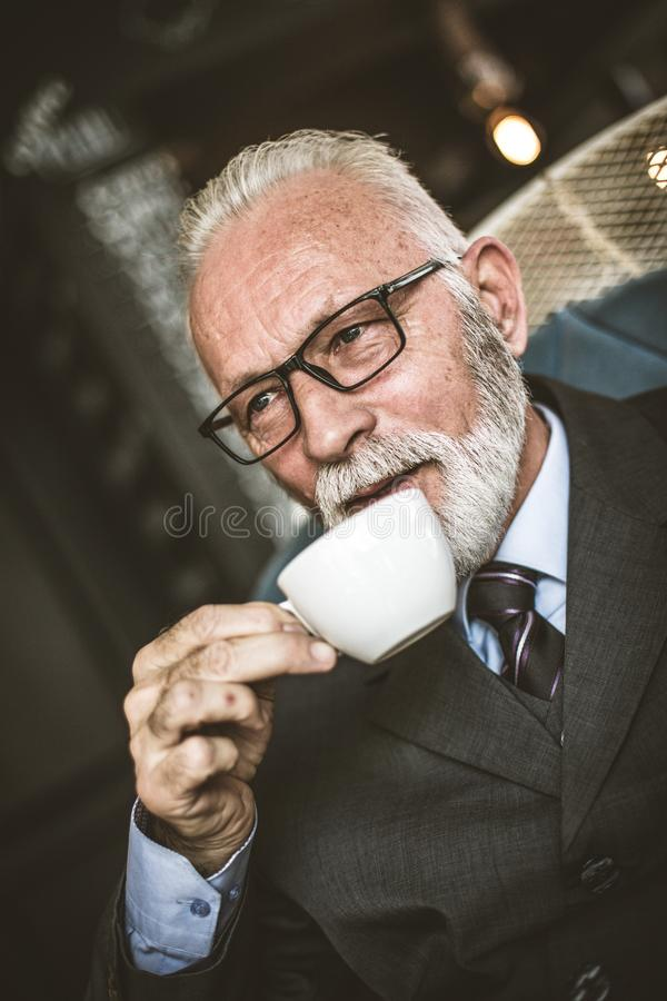 Senor businessman drinking coffee. Relax time stock image