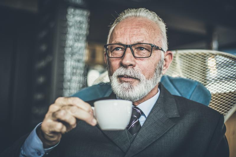 Senor businessman drinking coffee. Relax time. royalty free stock photo